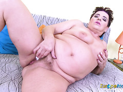 BBW in high heels stuffs a dildo and fingers into her hairy cunt