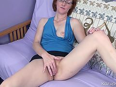 Nerdy milf redhead plays with her bush solo