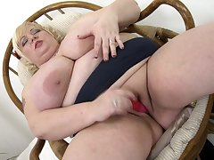 Busty blonde BBW granny Halina K. plays with her tits and pussy