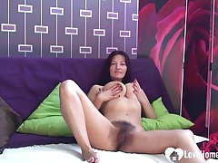 Brunette shows her chunky tits and masturbates