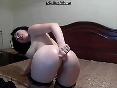 Solo benefactress enjoys anal masturbation with toys