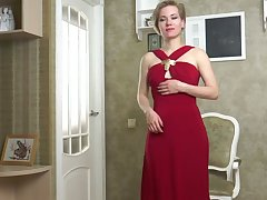 Delicious milf in red dress Lisa Young gets scanty and masturbates twat